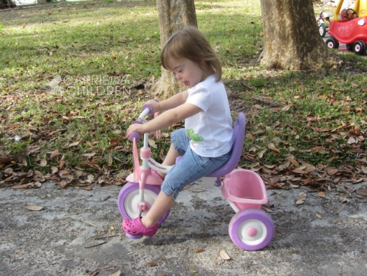 Molly Riding Bike Down Syndrome