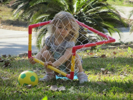 Maggie Practicing Soccer with Net